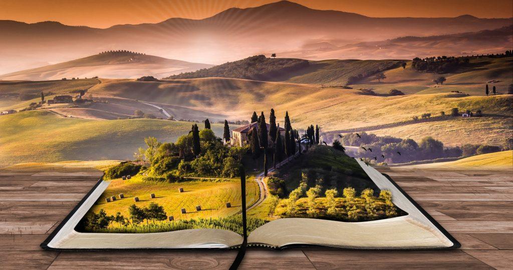 Bild visar ett landskap i form av åkrar och skogar i en öppen bok.